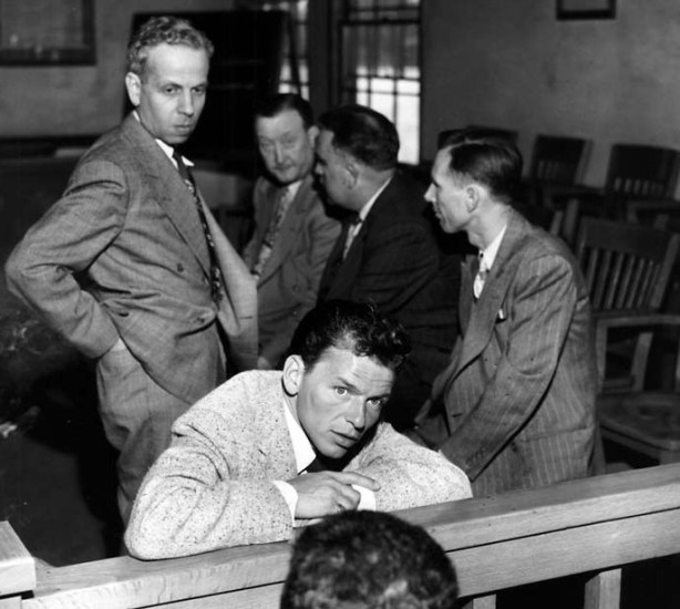 "April 10, 1047 file photo of Frank Sinatra in  Beverley Hills Municipal Court, in full view of his glaring accuser,  after being arrested on battery charges for slugging New York columnist Lee Mortimer. Los Angeles Times staff archive photo. Photo appears in Los Angeles Times book ""High Exposure: Hollywood Lives - Found Photos from the archives of the Los Angeles Times."
