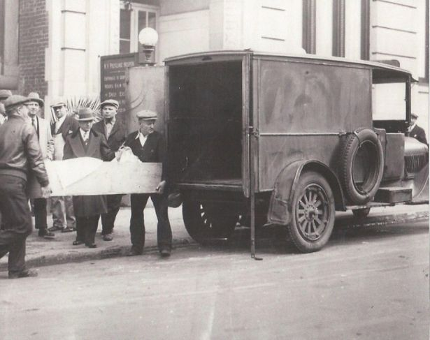 Body of A.R. being taken away, 1928.