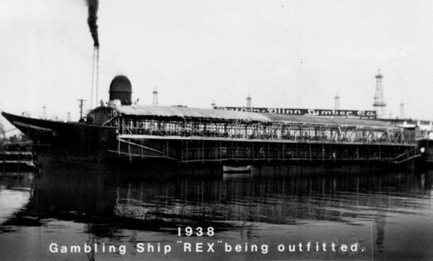 The Kenilworth aka The Star of Scotland, hardly recognizable as a barkentine with her masts cut off, being outfitted as the Rex gambling ship in early 1938. LAPL.