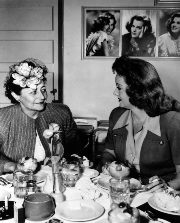 Esther Young with Bette Davis at a luncheon on dedication day. LAPL